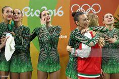 Reneta Kamberova, Lyubomira Kazanova, Mihaela Maevska, Tsvetelina Naydenova and Hristiana Todorova of Bulgaria react after winning bronze during the Group All-Around Final on Day 16 of the Rio 2016 Olympic Games at Rio Olympic Arena on August 21, 2016 in Rio de Janeiro, Brazil.