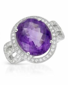 give this 7.86 CTW Genuine Amethyst White Gold Rhodium / Sterling Silver Ring to a special loved one.