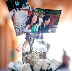 Joyce's Bridal likes this centerpiece idea...mason jar, some bird seed, forks, & a few pics...great idea...for your country wedding!