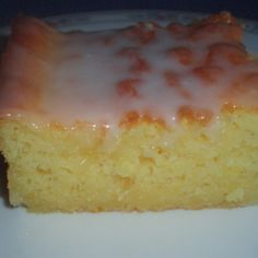 "My grandmother made a delicious, moist lemon cake like this from scratch years ago. It was my favorite. Now, with time as a rare ingredient in my kitchen, I use a box cake mix and add a few things of my own to make the same great taste my grandmother created. The lemon juice in the icing gives the cake such a ""fresh"" taste. It's rich so perhaps you can get 15 pieces out of a 9x13 because a small piece goes a long way. It's a favorite with a men's group my husband has meeting at our home ..."