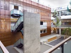 The four-story, open light court located in the center of the building (north side shown here) provides employees with natural daylight, reducing the need for artificial lighting. The large wood screen shown on this photo filters light from the south and provides visual warmth.
