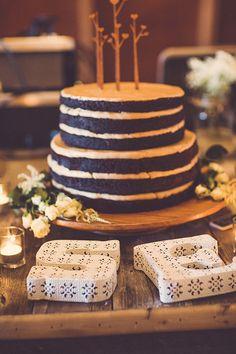 Dark chocolate baked cake | Photo by  Ryan and Heidi Studio | Read more -  http://www.100layercake.com/blog/?p=79446
