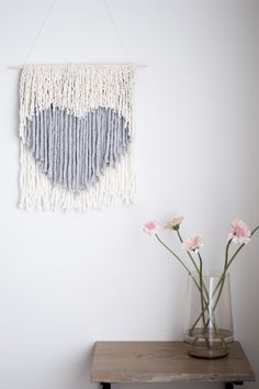 A simple no weave wall hanging tutorial in a heart shape. Make this modern, neutral Valentine's Day inspired home decor for your wall!