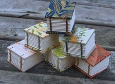 Tiny handmade coptic stitch books by MyHandboundBooks.                           Going to make this for sure!