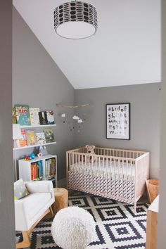 Henry's Balanced 'Lagom' Nursery — My Room | Apartment Therapy - I like the black and white graphic rug, the rainclouds mobile, the pouf, the white and natural wood rocker, all the natural wood...
