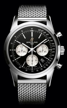 Breitling Transocean Chronograph. The sophisticated steel mesh bracelet perfectly accentuates the stylish dial. The look is bold and masculine.