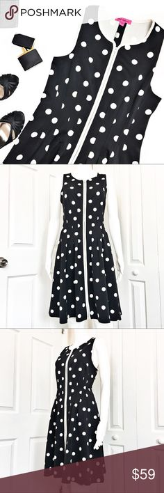 """Betsey Johnson Front-Zip A-Line Dress Adorable dress by Betsey Johnson in al all over polka dot print.  Has a flared front frock framed in white trim contrast.  Round neck with concealed front zipper with contrast placket.  Piped waist with s pleated A-Line skirt.  In excellent condition.  Material tag has been listed. Measurements laid flat: Bust:  18"""" Waist:  15"""" Hip:  22"""" Length from top of shoulder to hem:  37"""" *Measurements are approximate. Betsey Johnson Dresses Midi"""