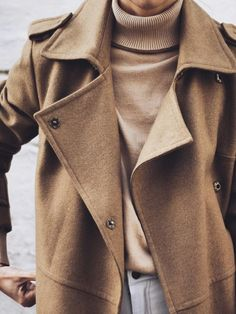 Classic camel colored wool trench coat, worn over a camel ribbed polar-neck  sweater, with a hint of grey off-white jeans b9b1638f7a1