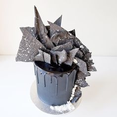 From the top; tempered chocolate shards were coloured with @creativecakedecorating black velvet colouring and splattered with silver edible paint. #cakesbycliff by cakesbycliff