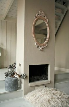 step-up floor, the slanted ceiling, the fireplace. This is how to maximize an awkward pillar in the middle of a room. Fireplace Mirror, Fireplace Design, Slanted Ceiling, Cozy Living, Living Room, Inspired Homes, Architecture Details, Decoration, Interior Inspiration