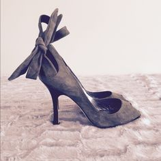 bebe Grey Suede Peeptoe Heels Shoe is grey suede with a black heel. Two long straps in the back can be tied into a bow or around the ankle. Only worn a few times. Gorgeous! bebe Shoes Heels