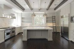 like: cabinets, sink in island; don't like: over the top counter thickness, marble everywhere