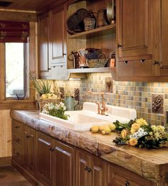 This Vegi Backsplash features our Le Radishes, Le Carrots and Le Artichoke. We love this cottage decor, rustic look in this country kitchen. www.landmarkmetalcoat.com