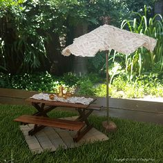 Ever tried making an umbrella? The mechanism that opens and closes the canopy is ingenious. This tutorial shows you how to make one for your fairy garden