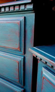 Blue painted dresser that has been distressed.