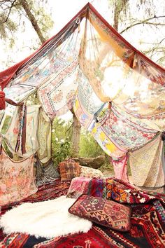 Super cool idea--make a festival sun canopy out of tapestries and scarves tied together and thrown over twine.
