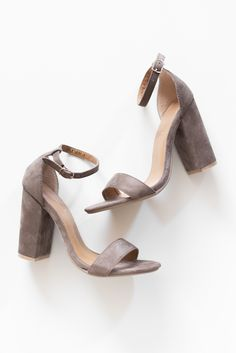 """Taupe heels with a soft faux suede texture. Wrap around ankle strap with adjustable buckle closure. Lightly padded insole with a rubber sole. Heel height measures approx. 4"""". - All man made material -"""