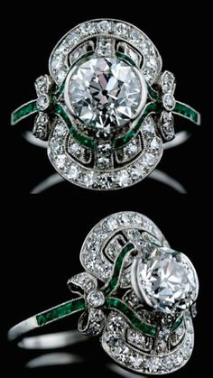 1.80 ct. Center Edwardian Diamond Ring with Emerald Calibre, This absolutely exquisite Edwardian diamond ring features a 1.80 carat sparkling European cut diamond set in a semi-bezel surrounded by small accent diamonds and calibre cut emeralds with adorable bow motif shoulders.