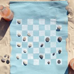 Leave bulky gear at home and hit the beach with a compact, portable game board fashioned from a place mat.