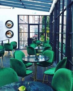 Green accents brighten the room and the brighter the shade really pops