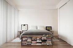 Book display at foot of bed