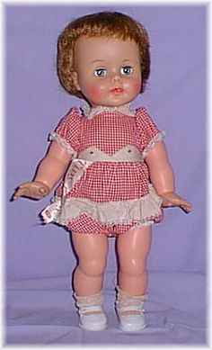 Kissy Doll - squeeze her arms together and she would kiss you.