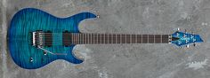 Carvin Guitars DC600C, deep aquaburst over flamed maple (FDQ), black gloss back and sides (BGB), natural body binding (BBE), Floyd Rose locking nut (LN), matching flamed maple headstock (FPH), reverse pointed 3+3 headstock (HR22), no inlays (NIN), stainless steel jumbo frets (STJF), 5 piece maple neck (5MM), A60N neck pickup w/ active electronics (A6N), A60B bridge pickup w/ active electronics (A6B), Dunlop straplocks (SL)