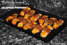 The hubs would kill these!! Bacon Wrapped Jalapeno Poppers!  #Real Housemoms #Bacon #appetizers