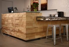A cash wrap for the new Reverie Boutique in Denver's LoHi that would make a stunning kitchen counter and seating area: