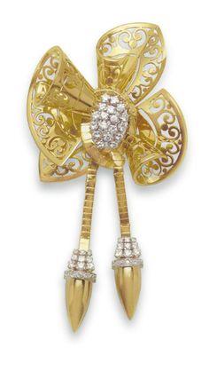 A RETRO DIAMOND AND GOLD BOW BROOCH - circa 1940 | Christie's