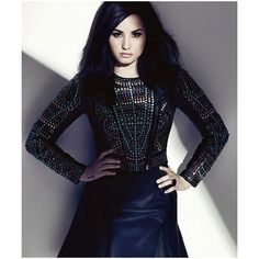 An image of Demi Lovato ❤ liked on Polyvore featuring demi lovato, demi, models, people and backgrounds
