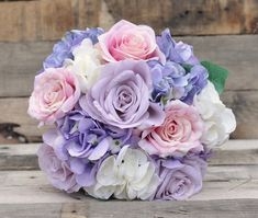 Silk Wedding Flower Bouquet made with Lavender Roses, Lavender Hydrangea, Soft Pink Roses and Ivory Hydrangea wrapped in Champagne Ribbon.