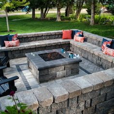 A square fire pit is situated perfectly within a surrounding seat wall built for endless entertaining.