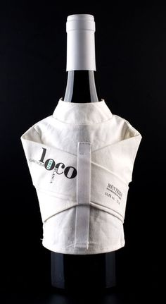 """Mod 12 - Loco - Vino Loco, A 'Crazy' Spanish Wine Wrapped in a Straitjacket. Creative agency LOLA Madrid is the behind the creative straitjacket packaging of Vino Loco, a """"crazy"""" white wine produced by Bodegas Canopy. The wine actually comes packages in a box that is padded, like a padded cell. This is a case where concept is king and the execution of this concept is flawless."""