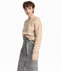 Camel. Sweater in a soft, loose wool-blend knit with heavily dropped shoulders and ribbing at neckline, cuffs, and hem.