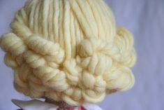 I never cut the yarn. I just work with four loops/eight strands at a time to keep it manageable.  Pins at part.  See comments