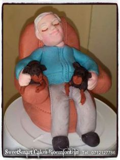 Fondant sleeping man with dogs For more info & orders, email SweetArtBfn@gmail.com or call 0712127786 Sleeping Man, Man And Dog, Fondant Figures, No Bake Cake, Cupcake Toppers, Icing, Cake Decorating, Plastic, Cakes