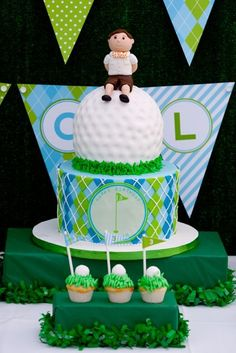 I will put the top golf-ball part sitting on a green sheet cake w/brown sugar sandtraps - individual cake pops w/pennants & each players name