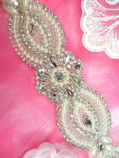 Applique Bridal Motif Crystal Rhinestone w/ Pearls Measures Approximately: 14.75 x 2.25  Made with Silver Beads, Crystal Clear Rhinestones, and
