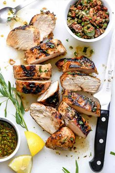 A simple marinade with two kinds of balsamic vinegar, fresh herbs, and grainy mustard gives this grilled balsamic chicken topped with an easy olive and sun dried tomato tapenade a classic Mediterranean flavor zing.