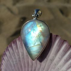 Uplift your spirits with this beautiful Rainbow Moonstone pendant set in sterling silver. This stunning piece features a polished flashy rainbow moonstone with a clean modern setting and open back. The striking blue glow and golden light radiance of this moon drop shaped crystal pendant will mesmerize you and brighten your day. Use code: MEANT4ME to get 20% off this beauty until 12/6/20. Click the photo to purchase now! #crystalhealing #moonstone #moonstonependant #goddessstyle #yogaoutfit Moonstone Pendant, Pendant Set, Crystal Pendant, Crystal Fashion, Moon Lovers, Brighten Your Day, Rainbow Moonstone, Crystal Healing, Gemstone Rings