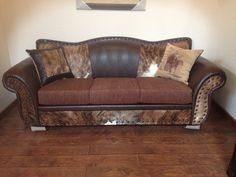 """""""Sofa has cowhide, bonded leather and fabric cushions. 94l x 36d x 37t."""" El Paso Saddle Blanket Co"""