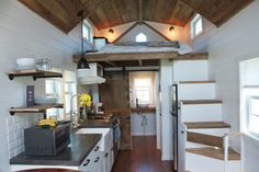 Modern farmhouse tiny house on wheels. reclaimed barn wood, concrete countertops, bamboo flooring.