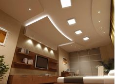 False ceiling with lights for bedroom with flat screen TV on opposite wall
