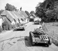 British Covenanter tanks pass through the village of Stockton in Wiltshire, England, August 1942. #WW2