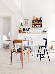 I'm not usually a fan of all white interiors, but I love the way it draws your eye to the mismatched chairs and sawhorse table, which make the whole thing decidedly unpretentious.