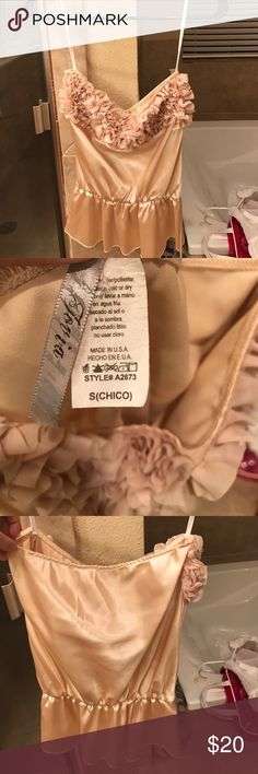 Strapless blouse Gold ish color, silky, strapless blouse. Looks brand new! Guess Tops Blouses