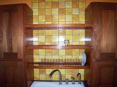 Check out this built in dish drainer over the sink...I want one...