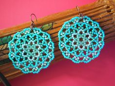 a lovely mix of glass seed beads including galvanized finishes make up intricate mandala discs. they make a subtle statement and would go well with a