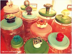 DIY: reuse glass jars - remove stickers with goo gone, spray paint lids, punch hole in lid and add drawer knob..